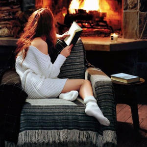 girl-reading-in-front-of-fire